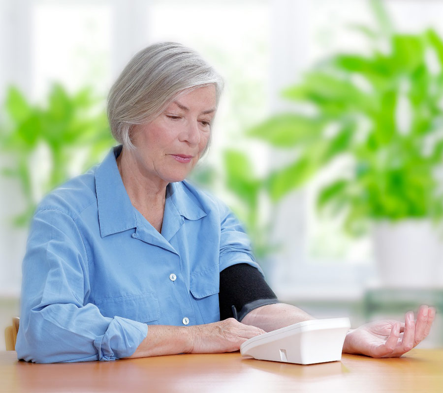 How should I measure my blood pressure at home?